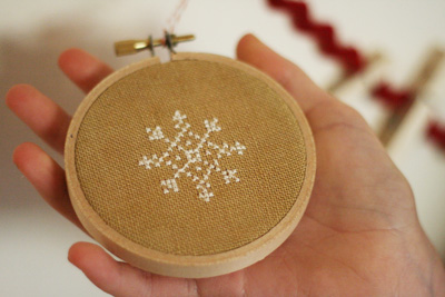 i feel like the most rebellious thing i could do right now is work on these cross stitch ornaments ive been so busy baking stuffing cookie bags